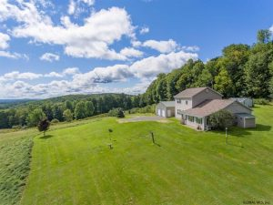 HARTWICK: TREE LINED DRIVEWAY TO LOVELY CONTEMPORARY HOME ON 13.77 ACRES photo